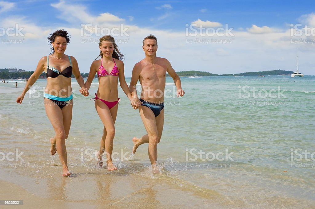 family running at the beach royalty-free stock photo