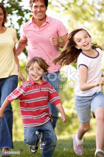 istock Family running in park 184946445