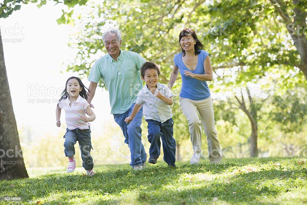 Family running in park stock photo