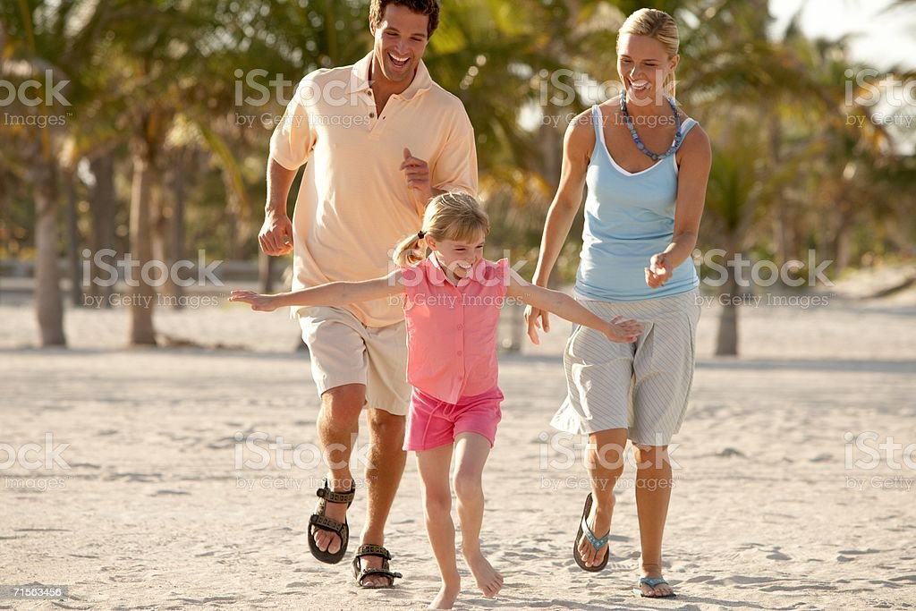 Family running on the beach royalty-free stock photo