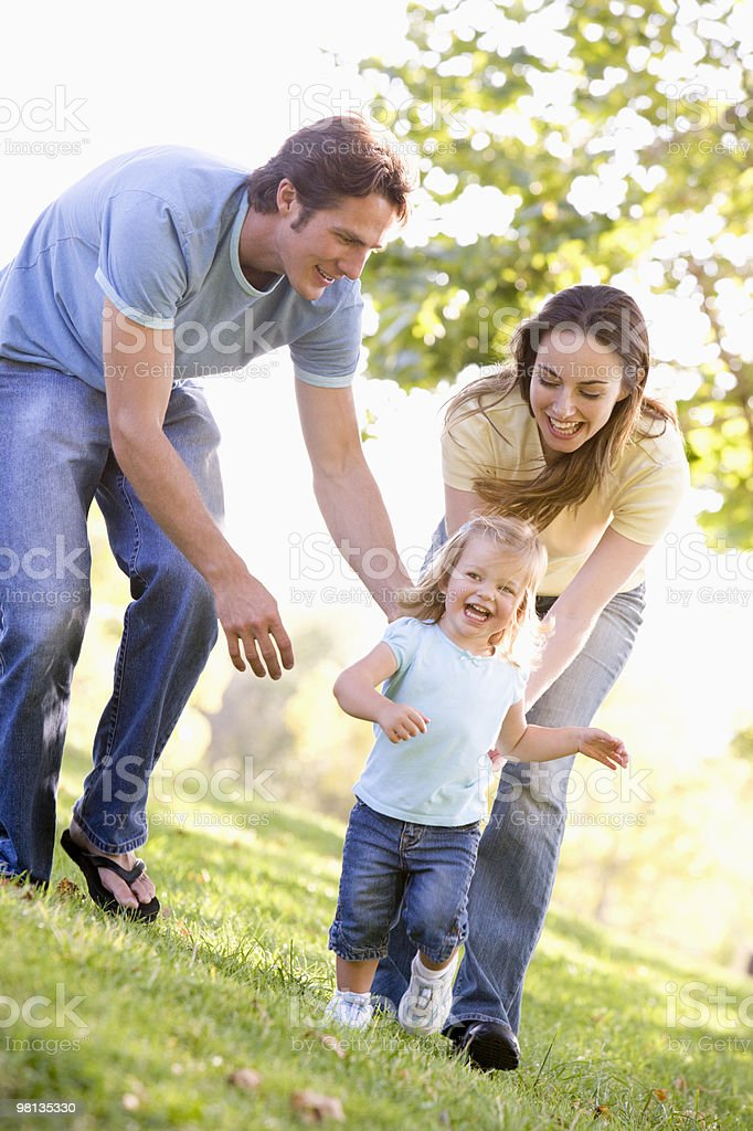 Family running outdoors royalty-free stock photo