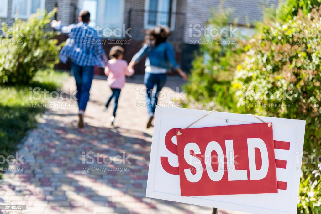family running to new house stock photo