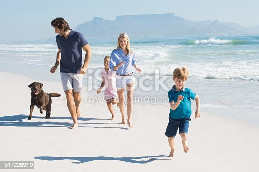 istock Family running with dog 517226910