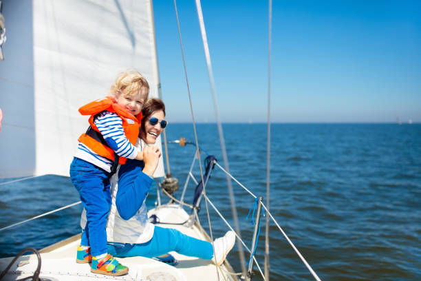 family sailing. mother and child on sea sail yacht. - sail stock pictures, royalty-free photos & images