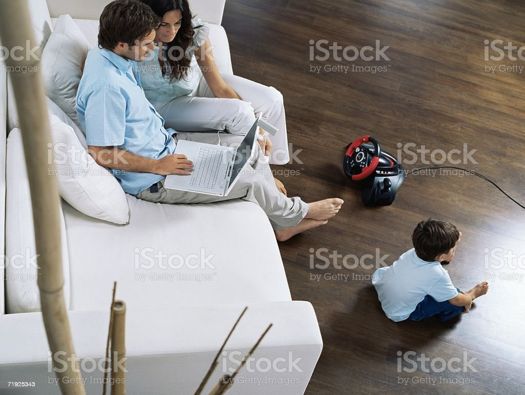 Family sat in living room royalty-free stock photo