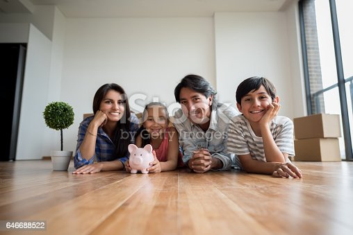 istock Family savings money for their new house 646688522