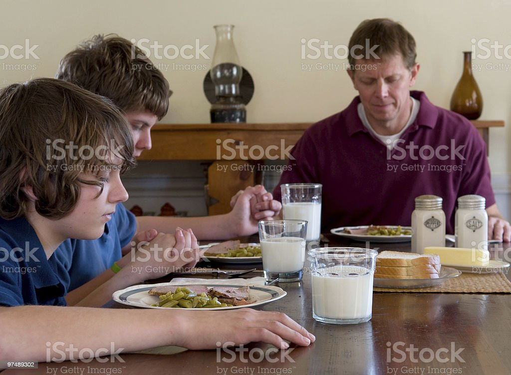 Family saying grace royalty-free stock photo