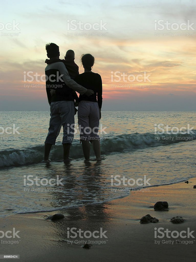 family. sea. sunrise. royalty-free stock photo