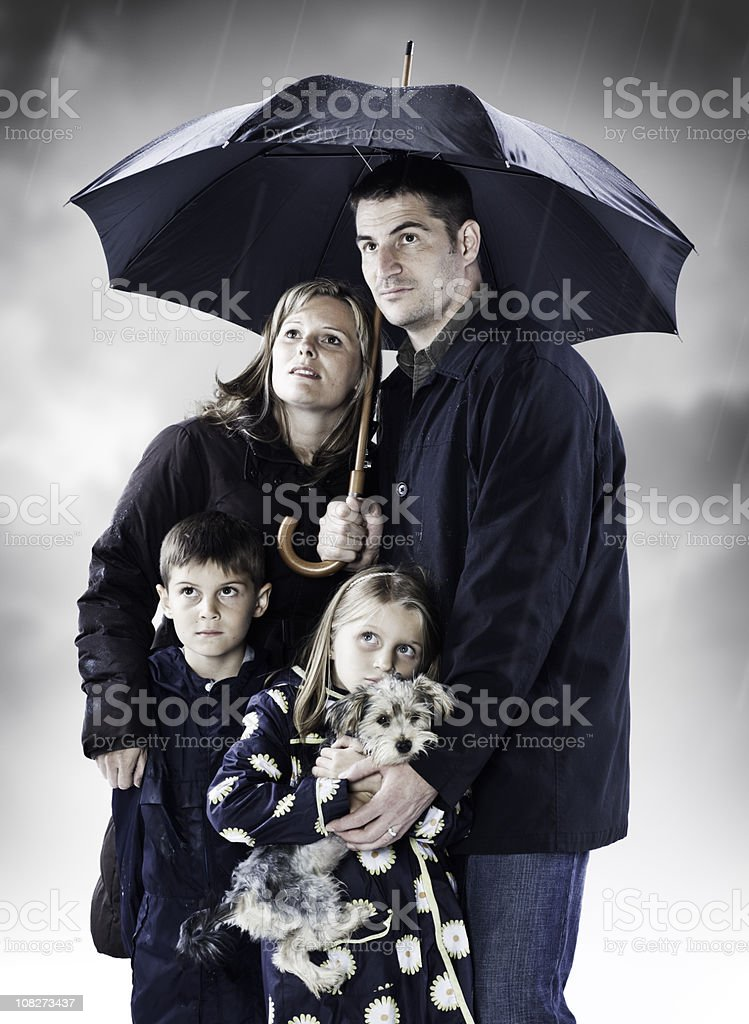 Family Seeking Shelter From the Storm stock photo