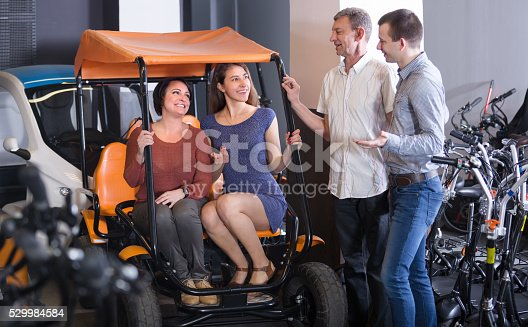 istock Family selecting grand tour electric at rental 529984584