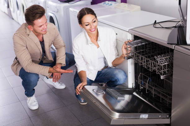 family selecting modern dishwasher - happy person buy appliances stock photos and pictures
