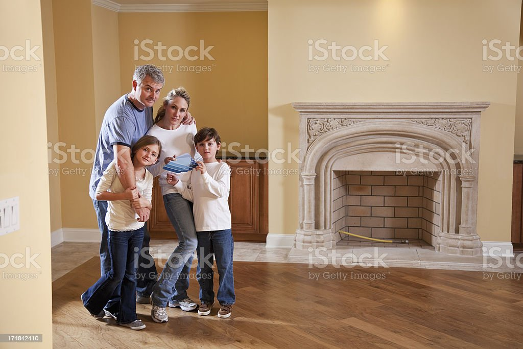 Family selecting paint color for new home stock photo