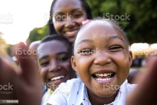 Family Selfie At The Park Stock Photo - Download Image Now