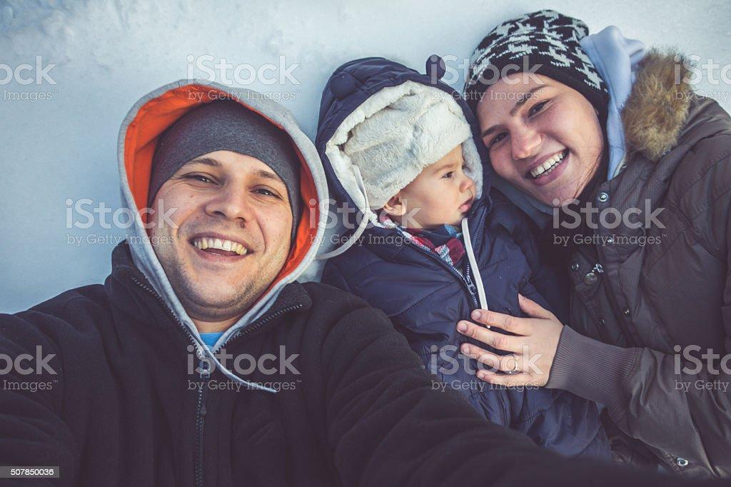 Family selfie in the snow stock photo