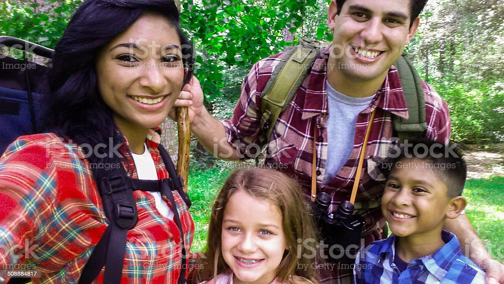Family 'selfie' using smart phone to capture camping trip. stock photo