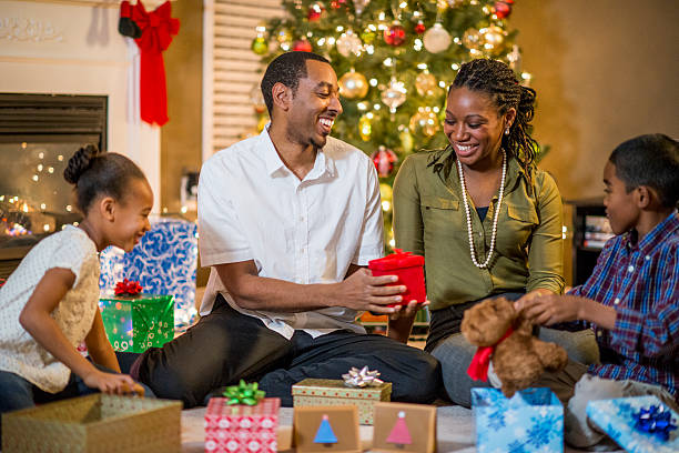 family sharing christmas gifts stock photo