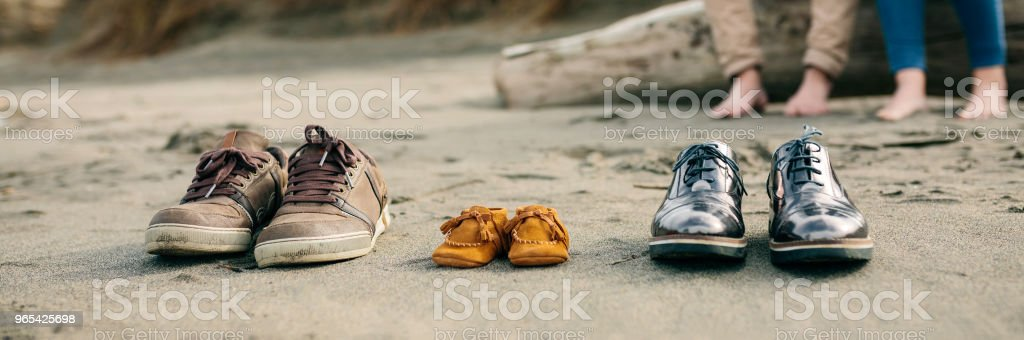 Family shoes in the sand royalty-free stock photo