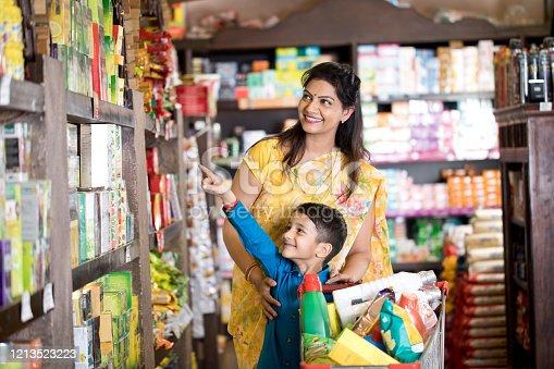 istock Family shopping at supermarket 1213523223