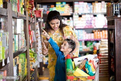 istock Family shopping at supermarket 1213523947