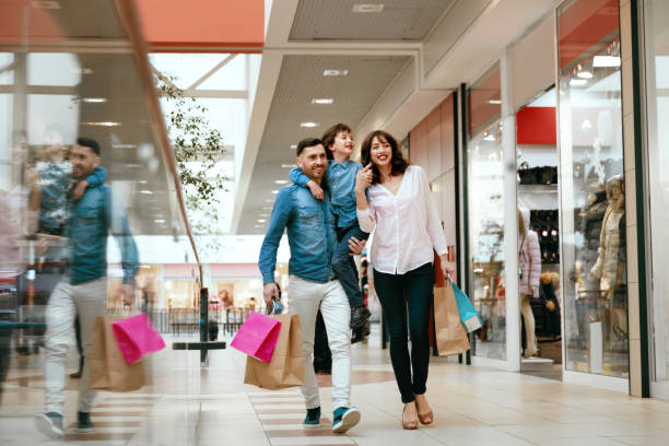 family shopping. happy people in mall - shopping mall stock photos and pictures