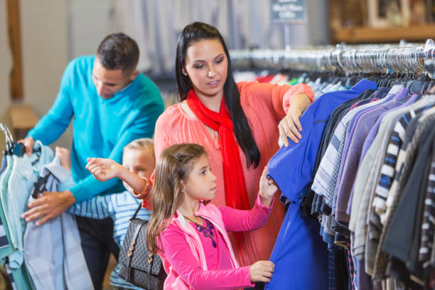 4b4b186df Family Shopping In Clothing Store Stock Photo & More Pictures of 25 ...