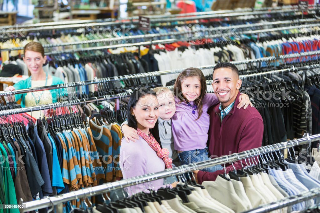 ee3910f8a Family Shopping In Clothing Store Stock Photo & More Pictures of 4-5 ...