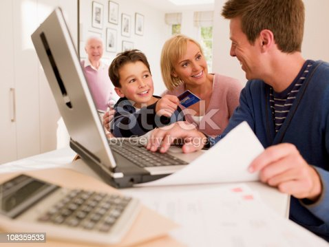 istock Family shopping online with credit card 108359533