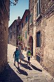 Family sightseeing beautiful italian town