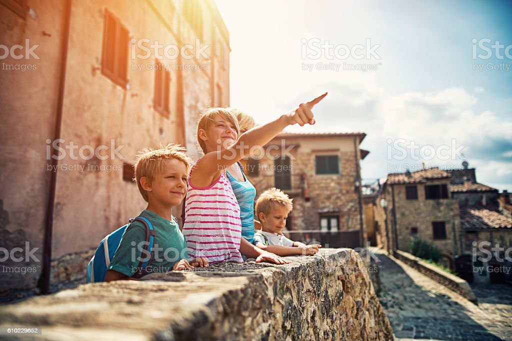Family sightseeing charming little Italian town in Tuscany stock photo