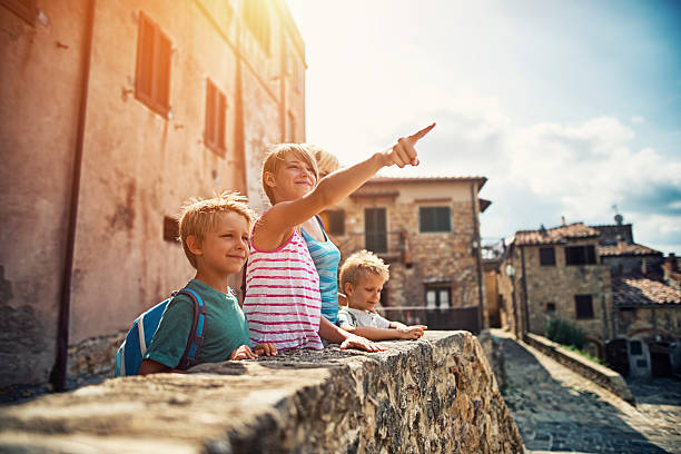 family sightseeing charming little italian town in tuscany - europe points imagens e fotografias de stock