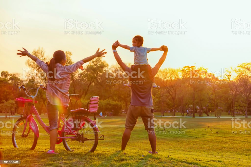 Family silhouette with bike, stock photo