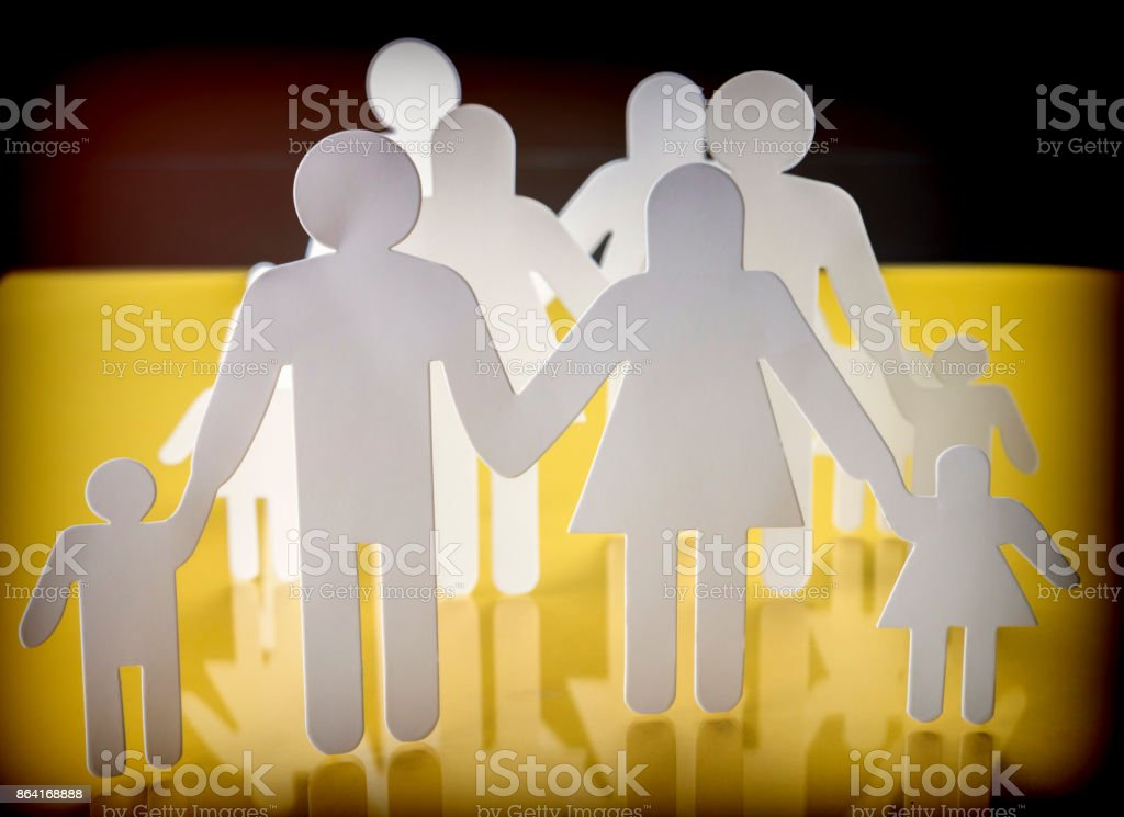 Family silhouettes with children isolated on yellow background, conceptual image royalty-free stock photo