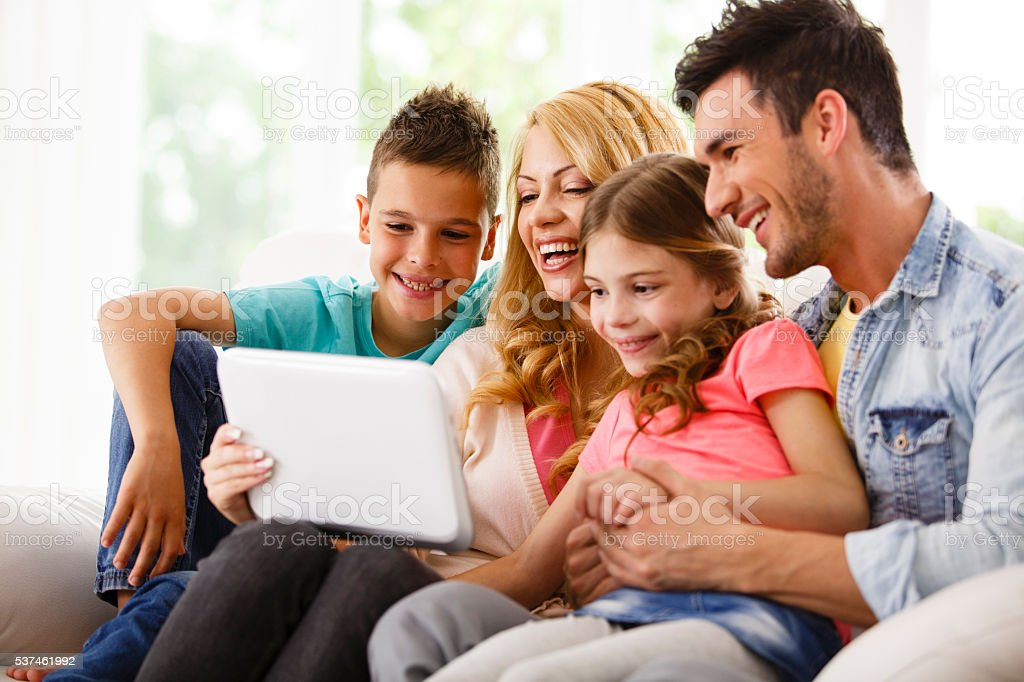 Family sing digital tablet together stock photo