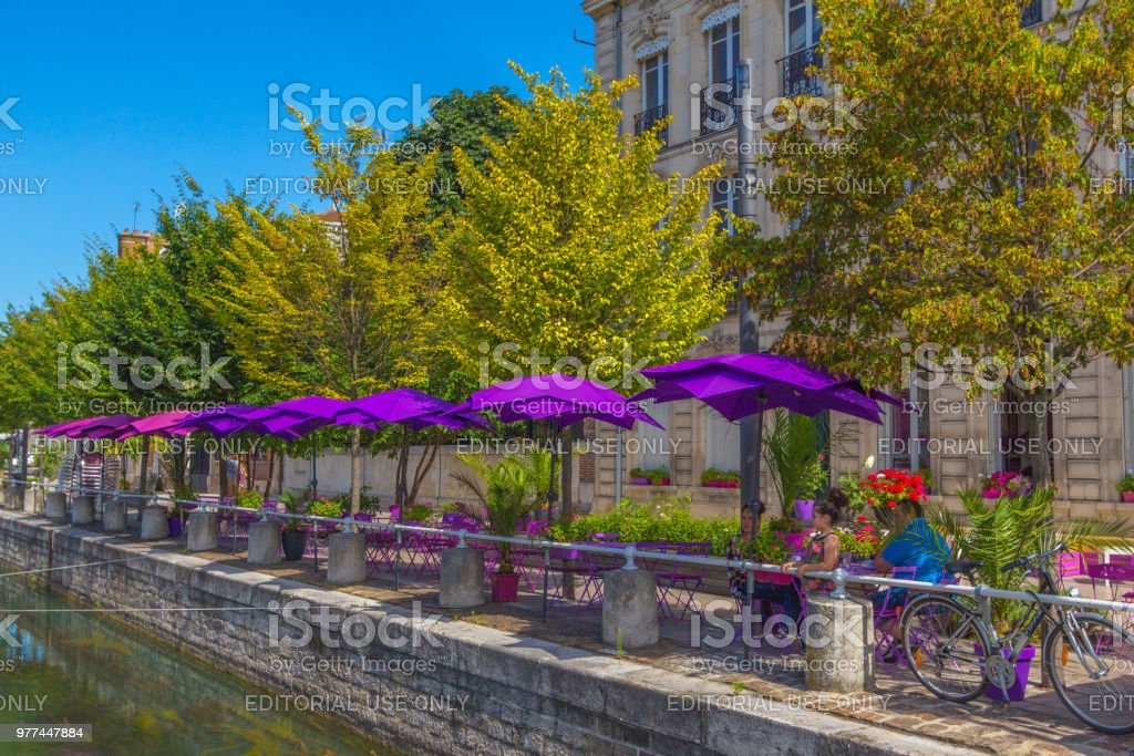 Family sitting at an outdoor cafe in France stock photo