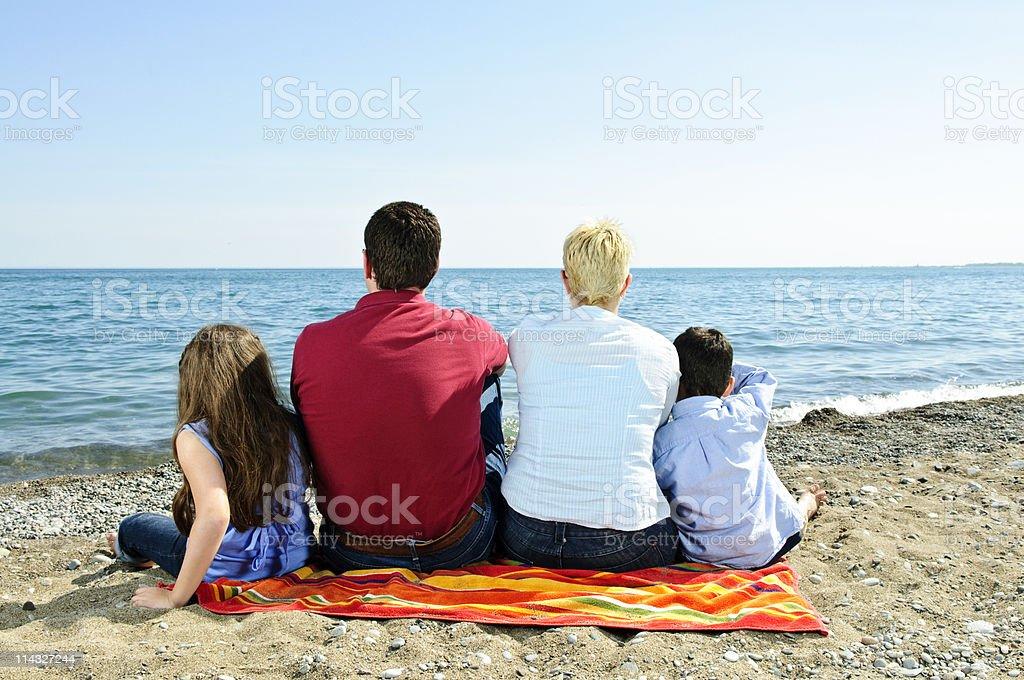 Family sitting at beach royalty-free stock photo