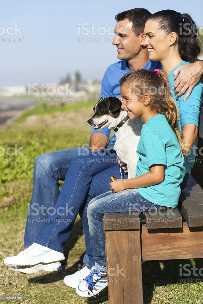 family sitting by beach royalty-free stock photo