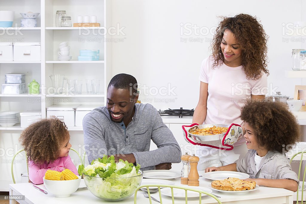 Family Sitting Down To A Meal stock photo