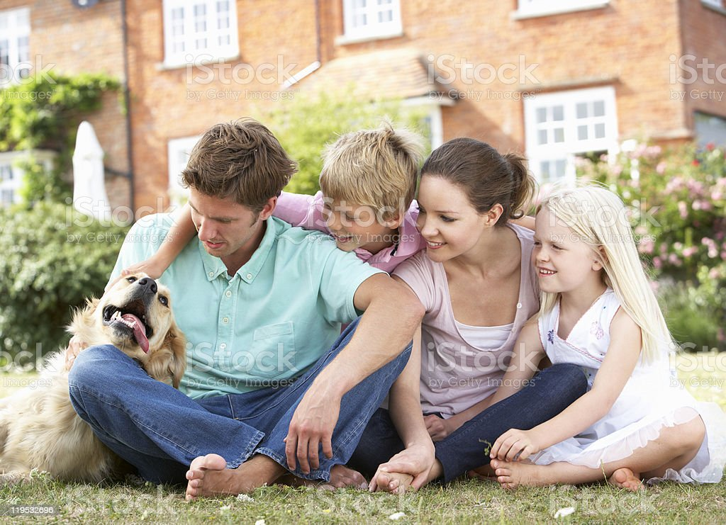 Family Sitting In Garden Together royalty-free stock photo
