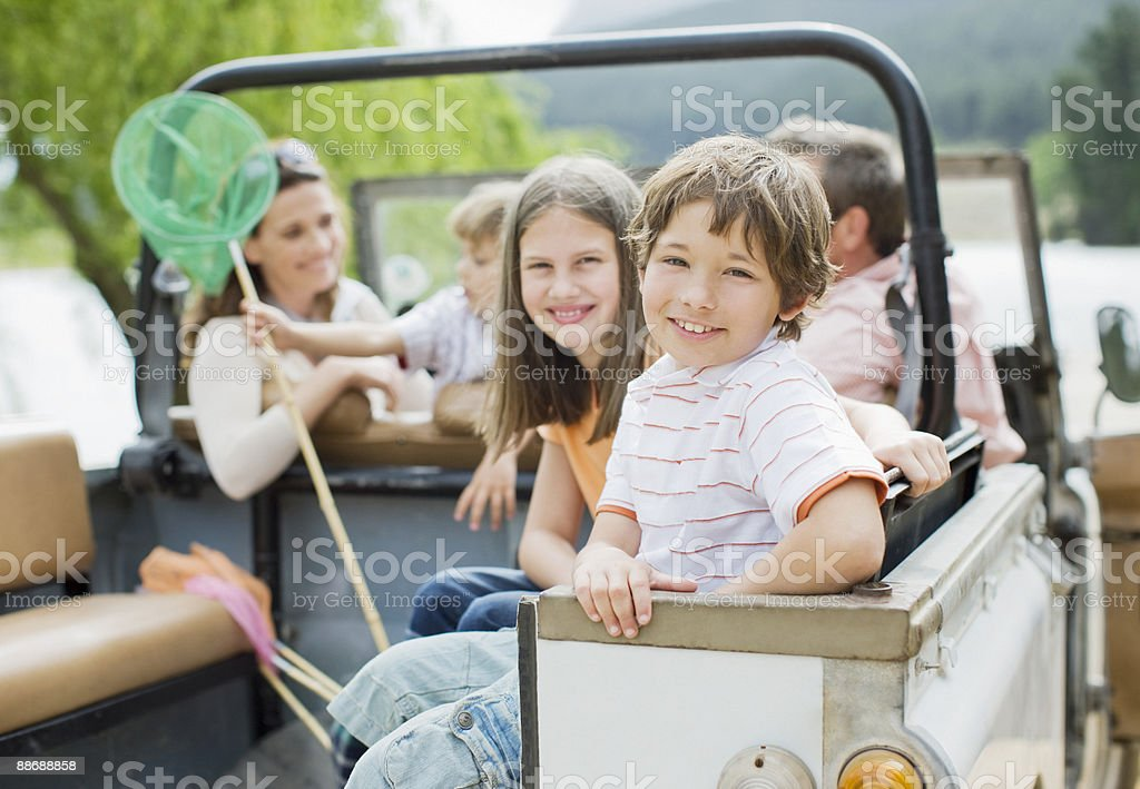Family sitting in jeep royalty-free stock photo