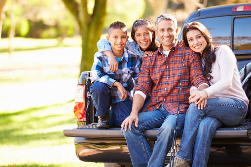 istock Family Sitting In Pick Up Truck On Camping Holiday 490777033