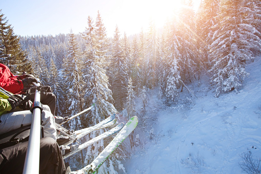 family sitting in ski lift