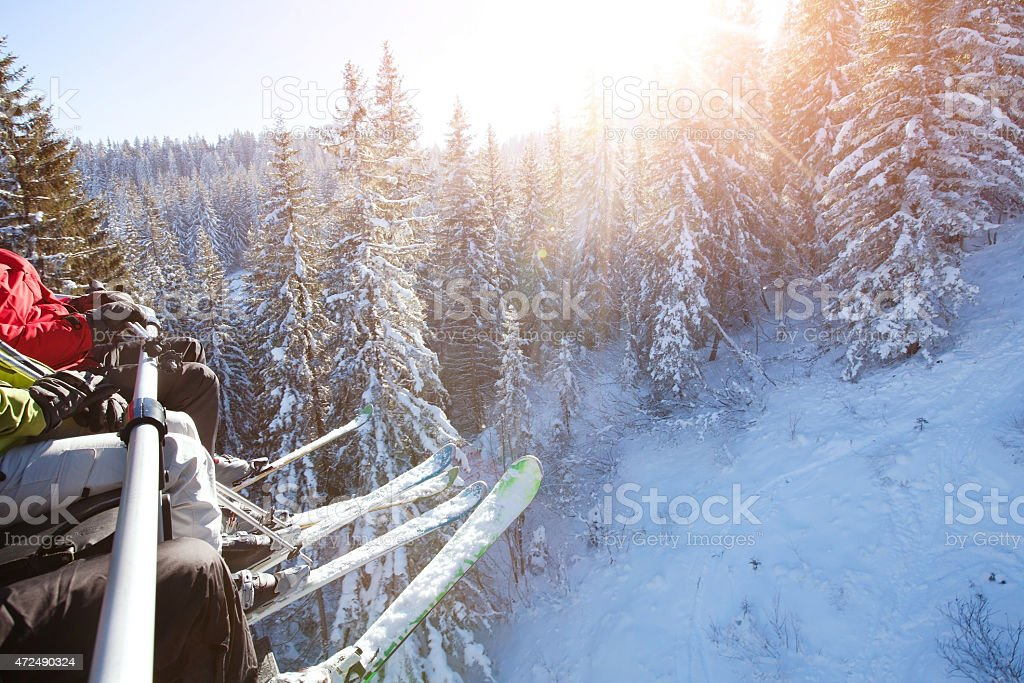 family sitting in ski lift stock photo