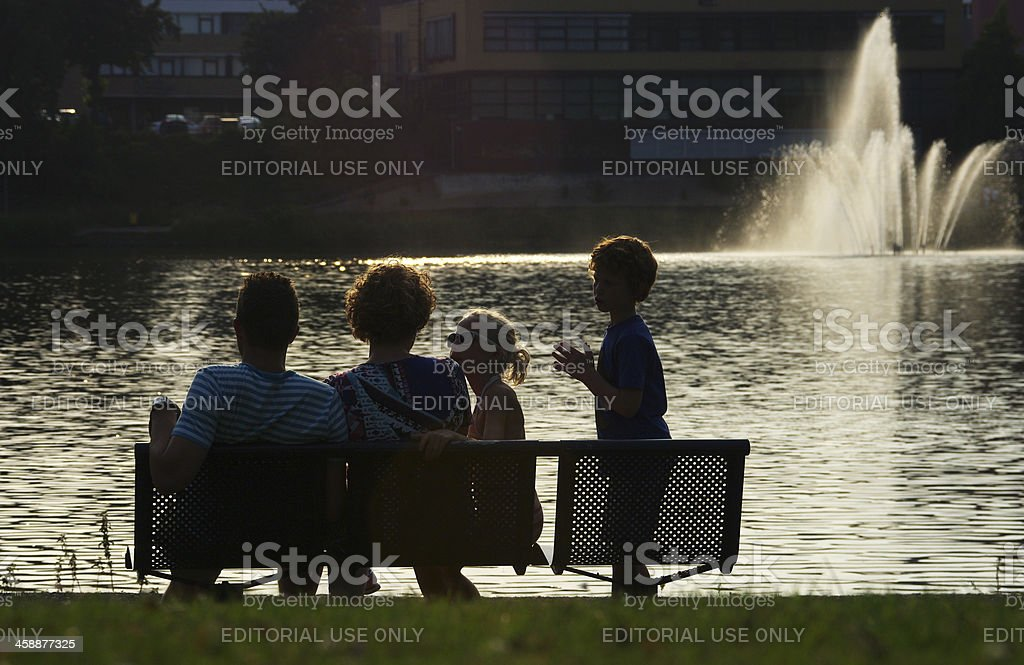 Family sitting in the city park royalty-free stock photo