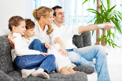 Family Sitting In Their Living Room Stock Photo - Download ...