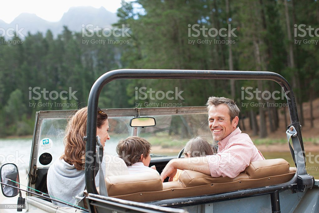 Family sitting in vehicle near lake royalty-free stock photo
