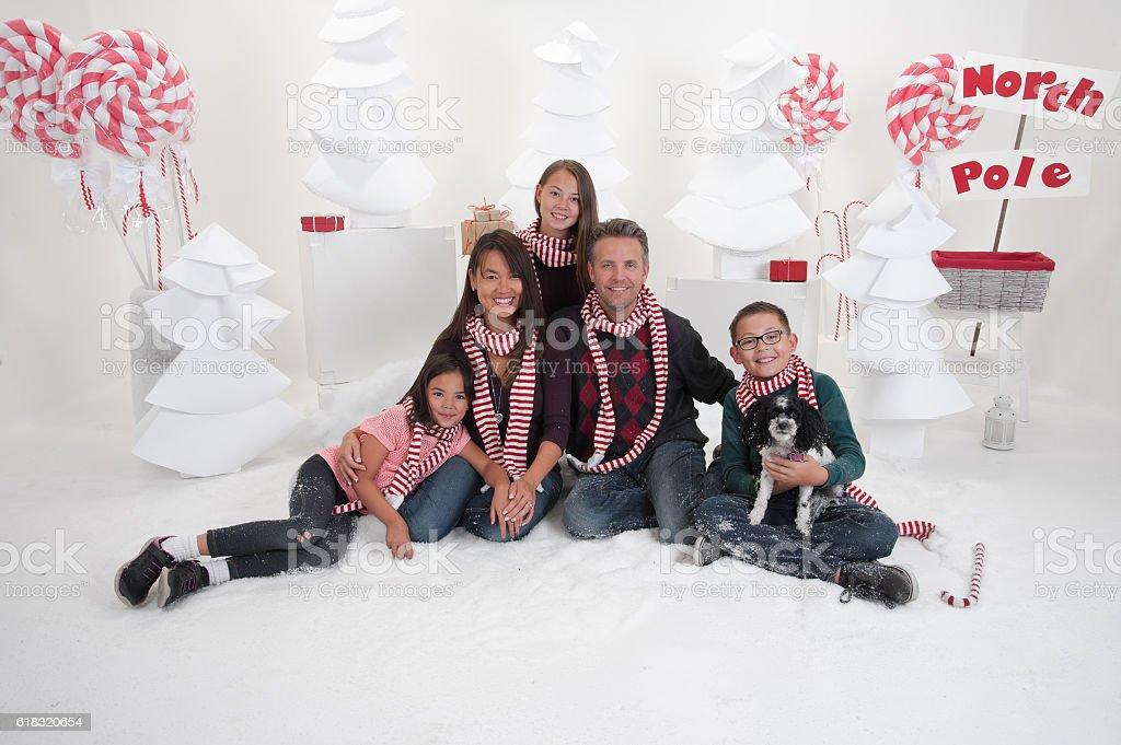 Family Sitting in Winter Wonderland stock photo