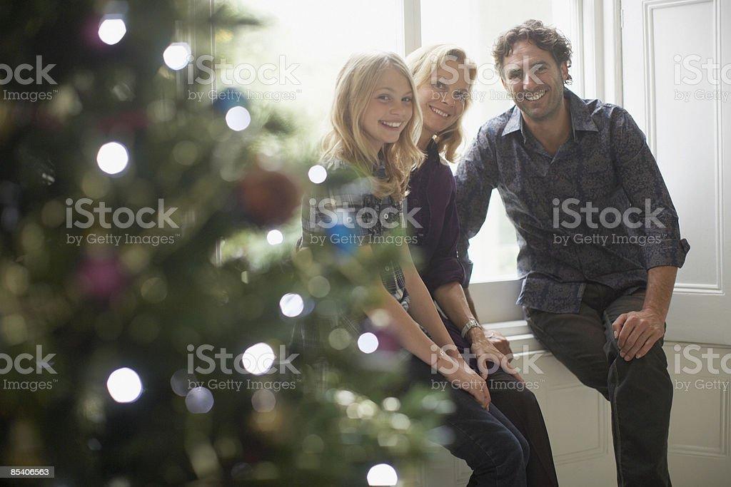 Family sitting near Christmas tree royalty-free stock photo