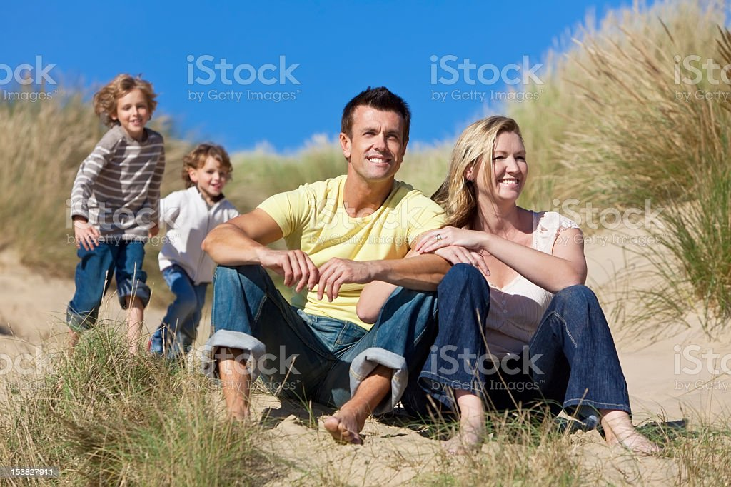Family Sitting on Beach Having Fun royalty-free stock photo