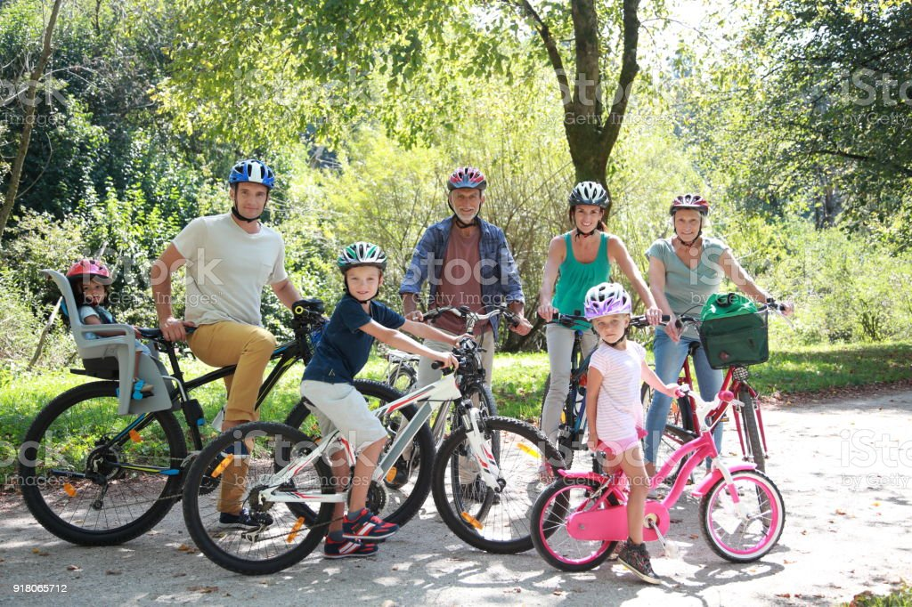Family sitting on bicycle stock photo