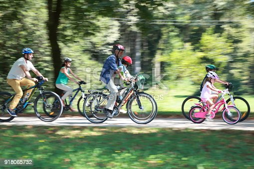 istock Family sitting on bicycle 918065732
